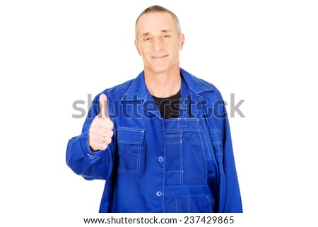 Portrait of repairman showing thumbs up. - stock photo