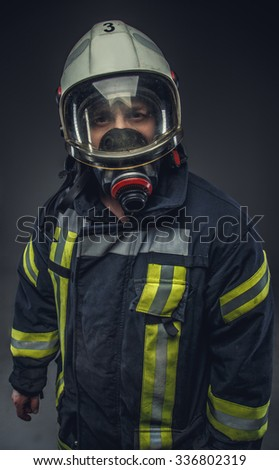 Portrait of rescue firefighter in helmet and oxygen mask.