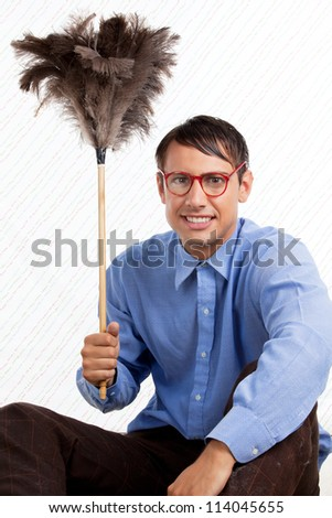 Portrait of retro male holding feather duster