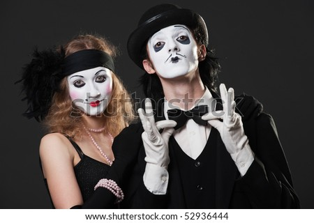 portrait of retro mimes over black background - stock photo