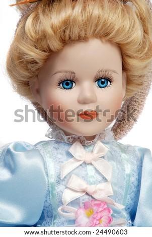 Portrait of retro porcelain doll face with blue dress - stock photo