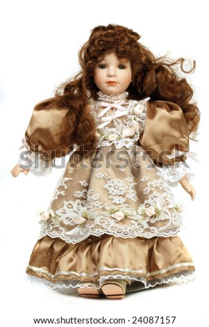 Portrait of retro porcelain doll with lace dress - stock photo