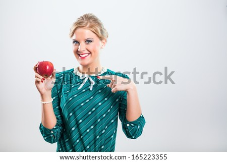 Portrait of retro woman pointing at apple,Apple for you - stock photo