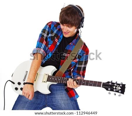 Portrait of rock artist posing in studio with guitar - stock photo