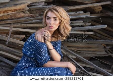 Portrait of romantic blond woman on rusty wood background. - stock photo