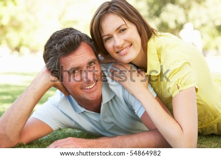 Portrait Of Romantic Couple In Park - stock photo