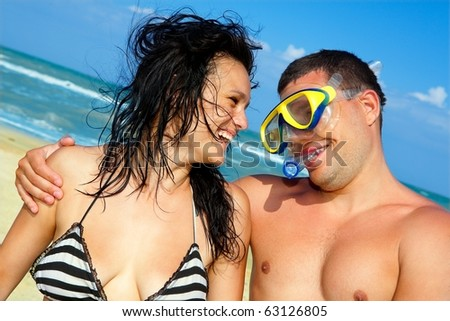 portrait of romantic couple in swimming masks enjoying on the beach