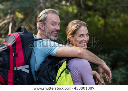 Portrait of romantic hiker couple in forest