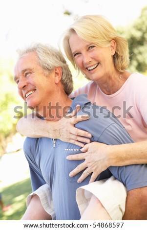 Portrait Of Romantic Senior Couple In Park - stock photo