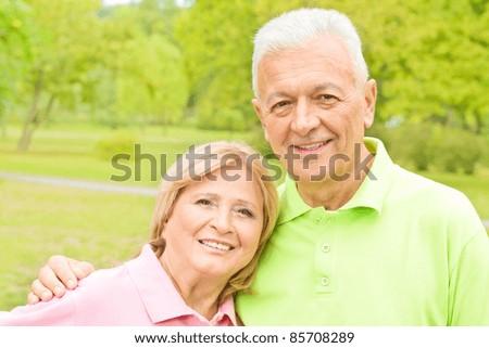 Portrait of romantic senior couple outdoors. - stock photo