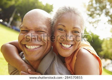 Portrait Of Romantic Senior Couple Relaxing In Park - stock photo