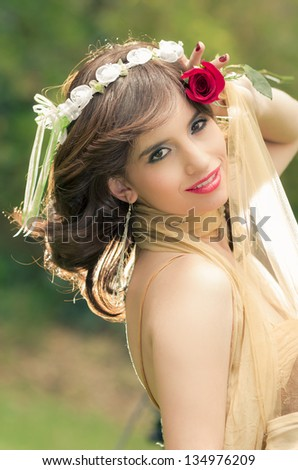 Portrait of romantic woman in fairy forest with a rose - stock photo