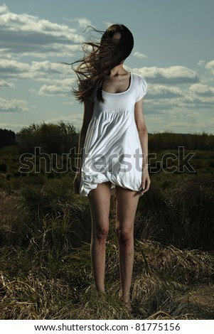 Portrait of romantic woman in nature - outdoors - stock photo