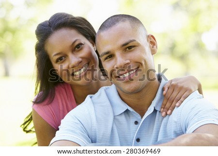 Portrait Of Romantic Young African American Couple In Park - stock photo