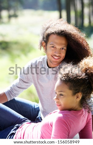 Portrait Of Romantic Young Couple In Countryside