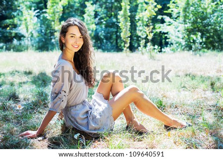 Portrait of romantic young girl in park
