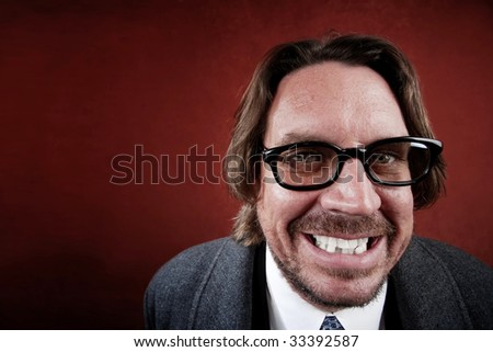 Portrait of rugged man with glasses making a funny face
