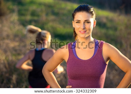 Portrait of runner jogger athlete gorgeous attractive woman outdoor exercise fit happy