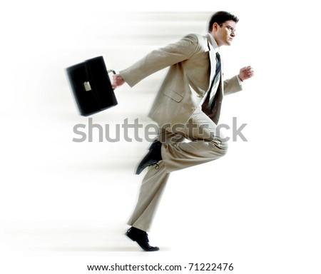 Portrait of running businessman against white background - stock photo