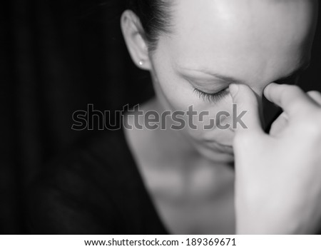 Portrait of sad and depressed woman deep in thought. Child abuse. - stock photo