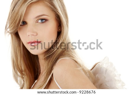 portrait of sad blue-eyed girl with angel wings - stock photo