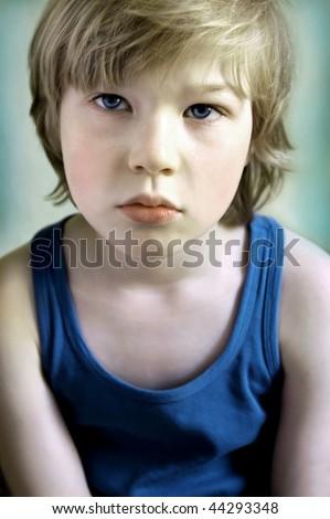 Portrait of sad boy - stock photo