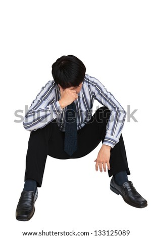 Portrait of sad businessman sitting on the floor, Isolated on white - stock photo
