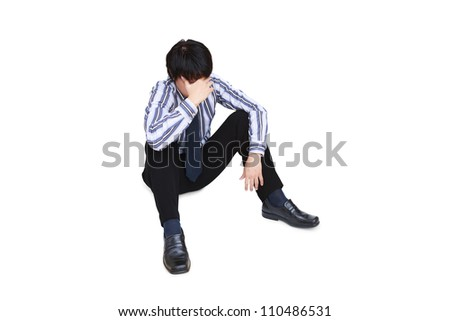 Portrait of sad businessman sitting on the floor, Isolated on white with clipping path
