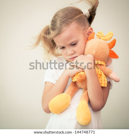 Portrait of sad child - stock photo