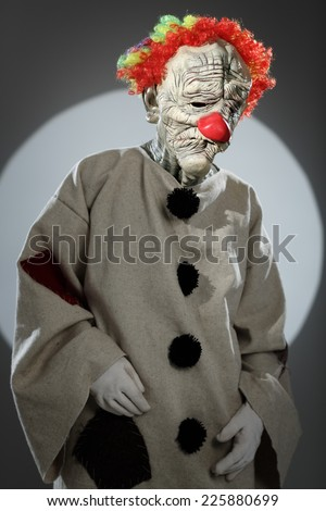 Portrait of sad clown with red nose. Halloween Costume. - stock photo