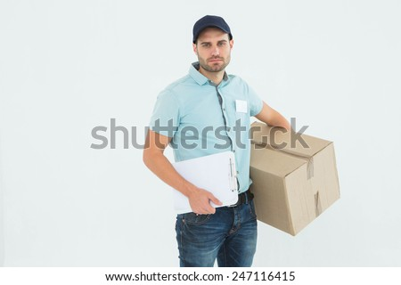 Portrait of sad delivery man with clipboard and package on white background - stock photo
