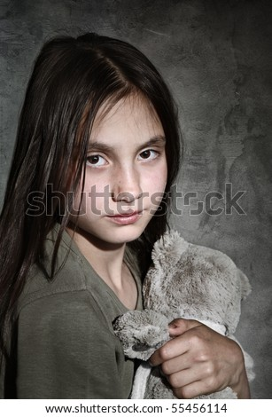 Portrait of sad girl with toy - stock photo