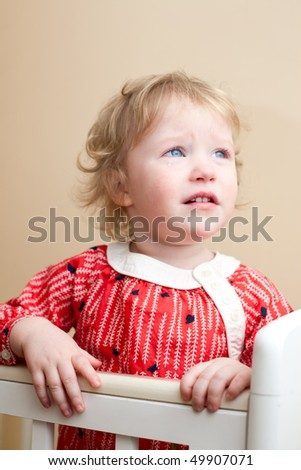 Portrait of sad little girl with tear in her eye - stock photo