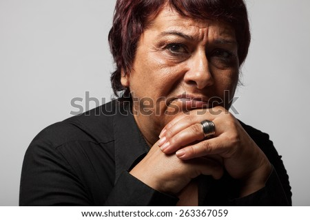 Portrait of sad lonely pensive middle aged woman. - stock photo