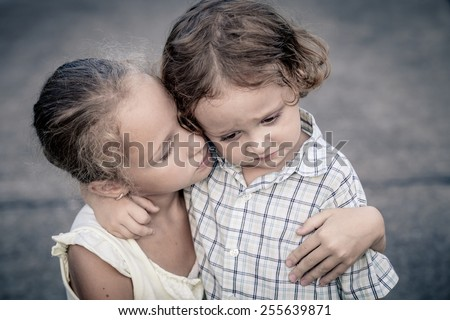 Portrait of sad teen girl and little boy at the day time - stock photo