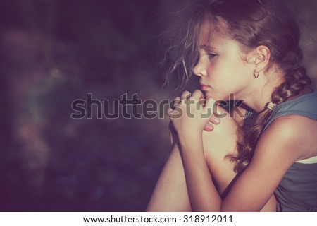 Portrait of sad teen girl at the day time. - stock photo
