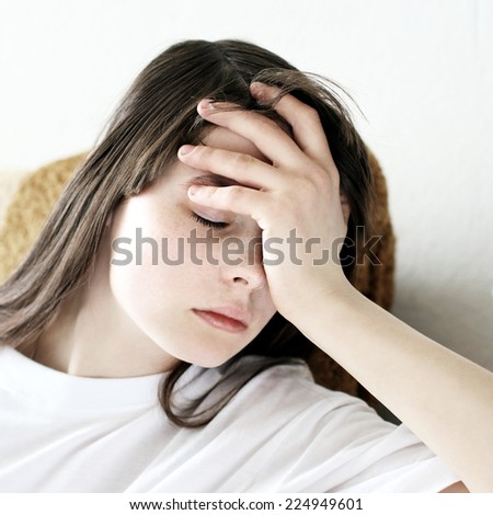 Portrait of Sad Teenage Girl at the Home - stock photo