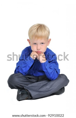 Portrait of sad thoughtful boy, isolated on white