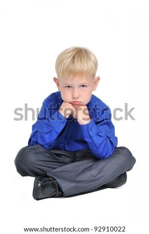 Portrait of sad thoughtful boy, isolated on white - stock photo