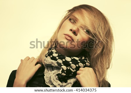 Portrait of sad young fashion blond woman outdoor. Female stylish model against a sky - stock photo
