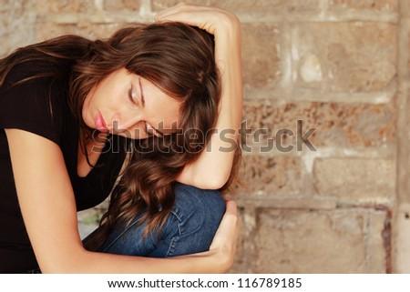 portrait of sad young girl - stock photo