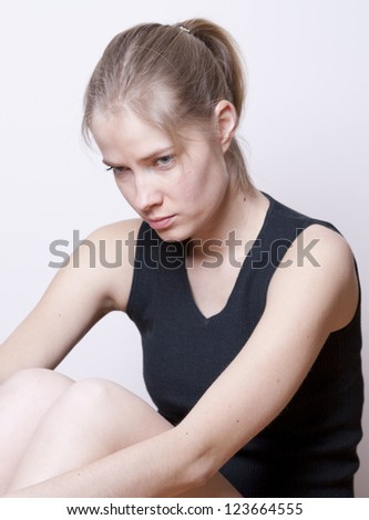 Portrait of sad young woman - stock photo