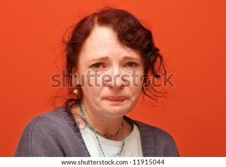 Portrait of sad young woman who's been crying - stock photo