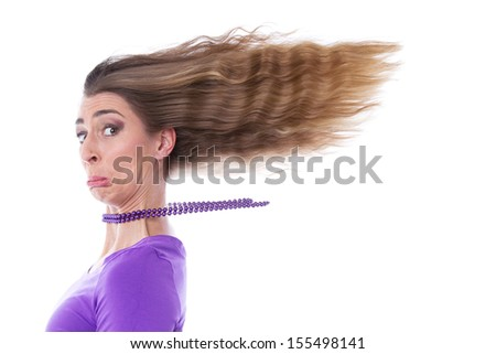 Portrait of sad young woman with flowing hair - stock photo