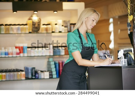 Portrait Of Sales Assistant In Beauty Product Shop - stock photo