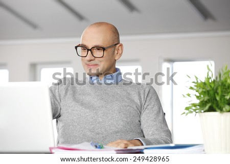 Portrait of sales man working on laptop at office. Business people.  - stock photo