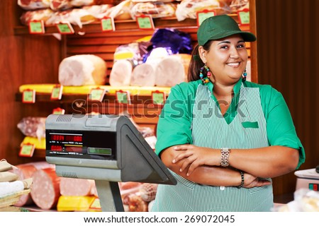 Portrait of sales person worker or assistant seller in supermarket store shop - stock photo