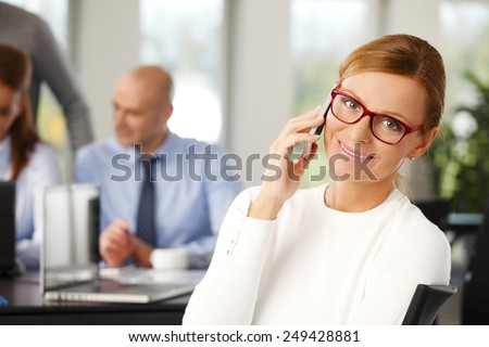 Portrait of sales woman has a call while sitting at training at office. Business people. - stock photo