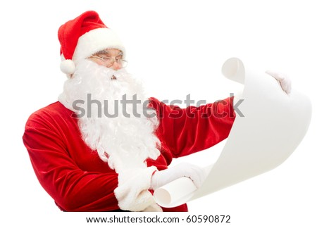Portrait of Santa Claus reading big letter attentively - stock photo