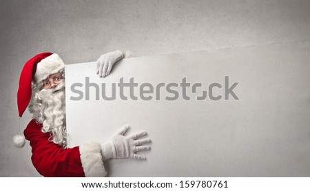 portrait of Santa Claus showing billboard - stock photo